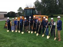 Batavia City SD officials, Campus CMG team members, and NYS Assemblyman Stephen Hawley pose with golden shovels.